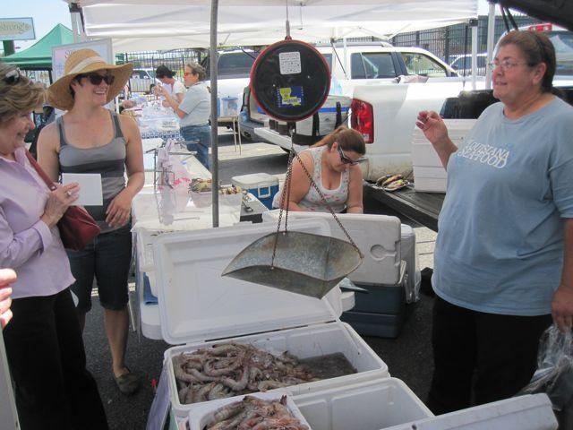 Clara Gerica (right) shares some seafood tips, and stories, at the Crescent City Farmers Market.