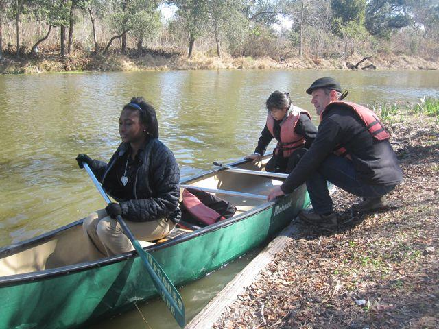 Dan Forman helps middle school students Maritza Zamora and RonDeaja Craig get underway on a City Park lagoon.