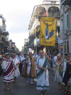 The Krewe of Cork parades during NOWFE's Royal Street Stroll.