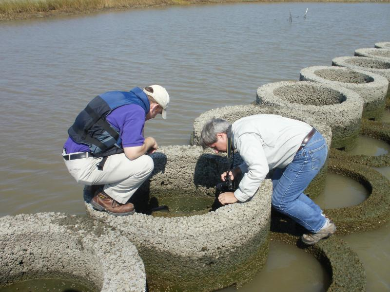 LSU professor Steven Hall, left, and The Nature Conservancy conservation program director Richard Martin check progress of an artificial oyster reef in Vermilion Bay.