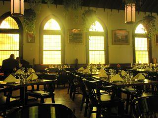 Amber light from stained glass windows fills this church-turned-restaurant.