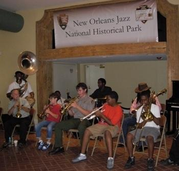 A group of locals both old and young perform together at the new Orleans Jazz National Historic Park.