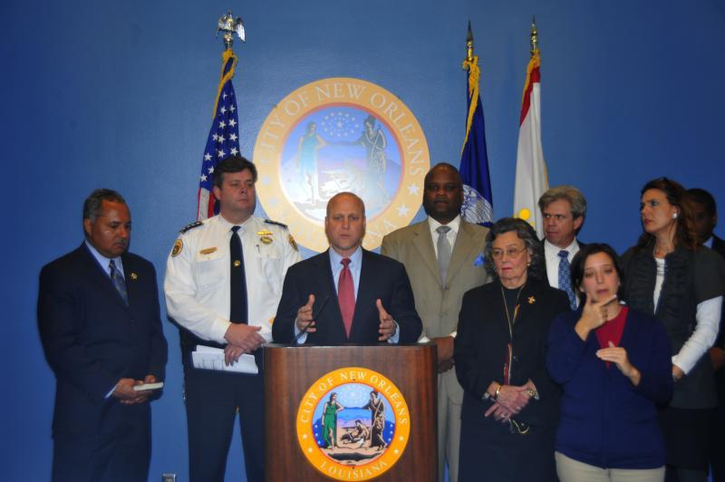 Mayor Mitch Landrieu announces a new crime-fighting plan alongside city officials.