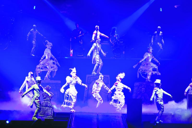 Scene from Cirque du Soleil show that features a Michael Jackson dance and music.