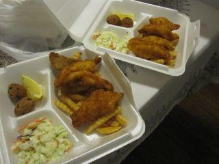 Cartons of fried fish are filled with tradition at New Orleans Lenten fish fries.