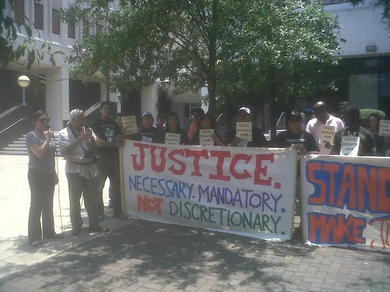 Protesters rally at federal courthouse in New Orleans.