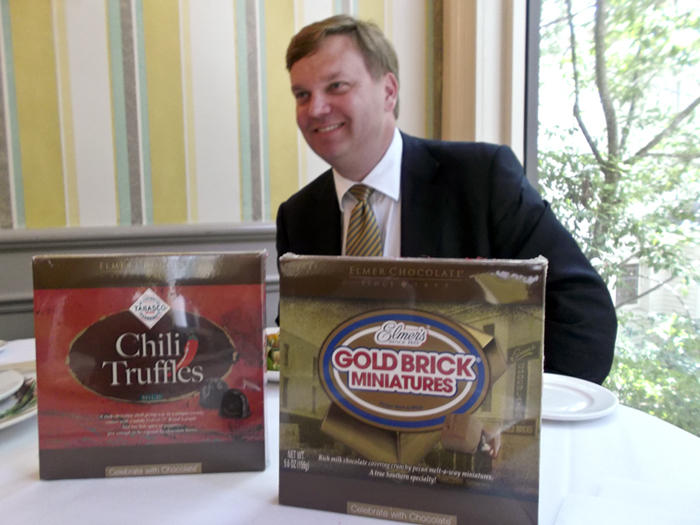 Rob Nelson, president of Elmer's Chocolate, with his new boxes of chocolates.
