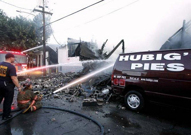 Firefighters work to extinguish the five-alarm fire that destroyed New Orleans' beloved Hubig's Pies.