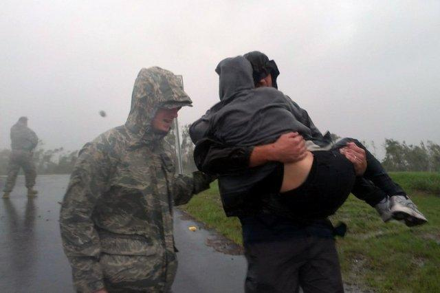 An Airman from the Louisiana Air National Guard assists local authorities with evacuating residents of Braithwaite, La., in Plaquemines Parish as Hurricane Isaac makes landfall, Aug. 29, 2012.