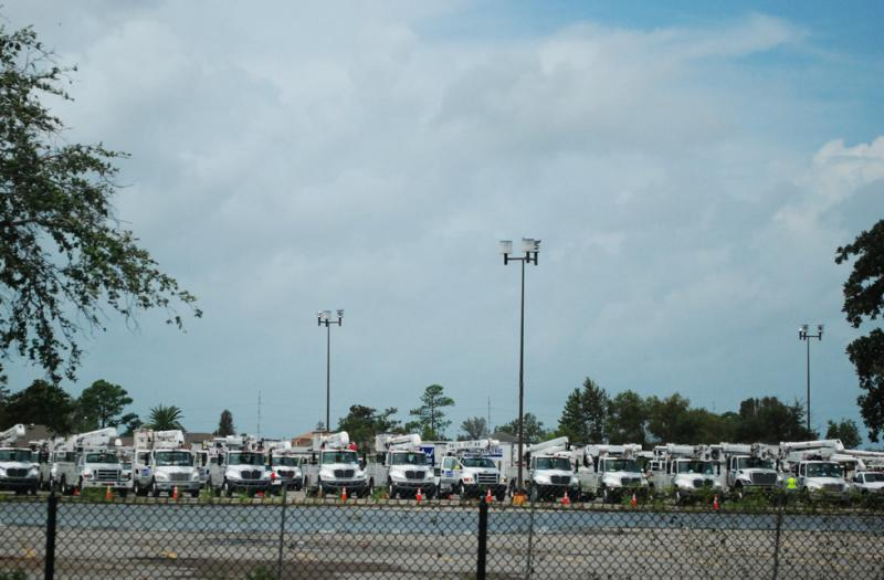 Hundreds of utility trucks were staged in New Orleans East, two days after Hurricane Isaac passed through the city.