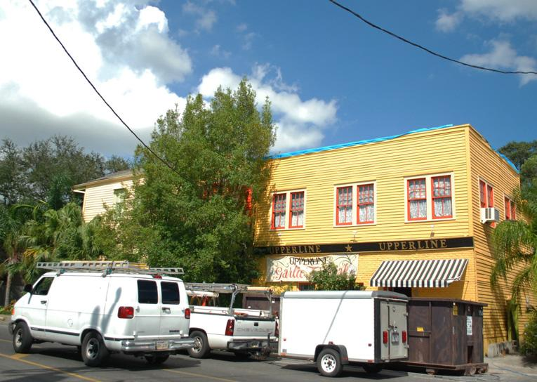 Heavy winds from Hurricane Isaac brought roof damage to many New Orleans structures like Upperline, a popular restaurant in the Uptown neighborhood.