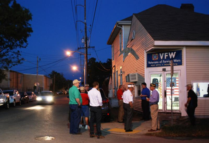 Members of New Orleans VFW Post 8973 converse outside their Lyons Street hall before an October meeting. The Uptown building has two apartments on the second floor that the group has renovated and plans to rent.