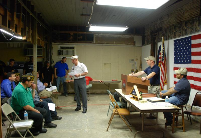 Marshall Hevron speaks at the October meeting of the Alfred E. Flynn VFW post in New Orleans. Flynn was a resident of the Uptown neighborhood where the post is located and died in World War II.