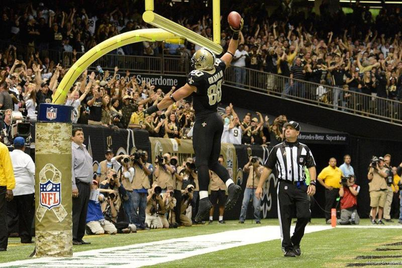 Jimmy Graham dunks the football over the goalpost after a touchdown during the Saints 31-27 victory over the Atlanta Falcons Sunday afternoon.