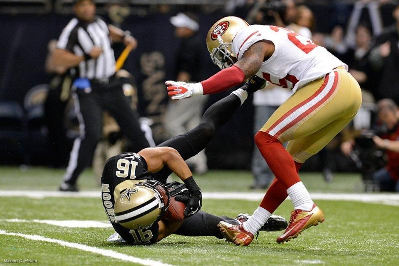 Lance Moore makes a diving reception Sunday at the Superdome against the 49ers.
