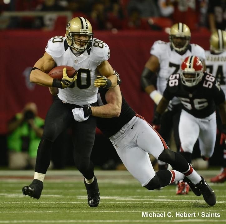 Jimmy Graham gets wrapped up on a run last night in Atlanta.
