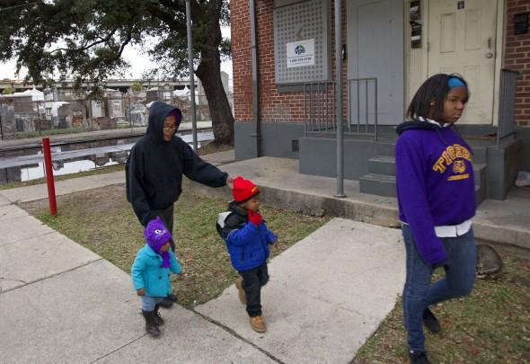 Charmaine Williams goes for a walk with her grandchildren and daughter in the Iberville public housing development. Archaeologists have confirmed that part of the housing complex sits on an old cemetery, likely once part of St. Louis No. 1.