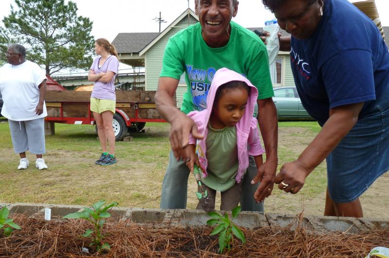 Chester Blunt gets help planting from his grandaughter.
