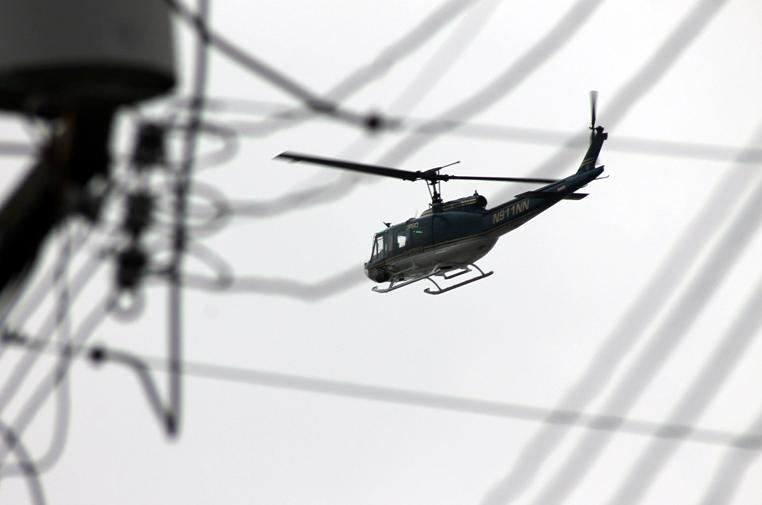 A Jefferson Parish Sheriff's Office helicopter circles the 9th Ward during a manhunt early Saturday morning.