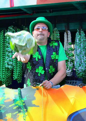 A rider tosses a cabbage during St. Patrick's Day festivities.