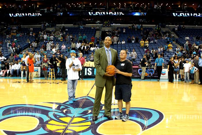 Hornets Head Coach Monty Williams with a fan during a postgame celebration of the season