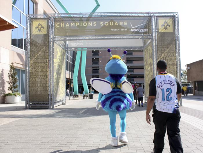 Hugo headed into the game from Champions Square, with his Beekeeper attendant. The Beekeeper served as Hugo's assistant during appearances and games.