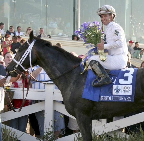 Revolutionary and jockey Javier Castellano, the winners of the 100th Louisiana Derby.