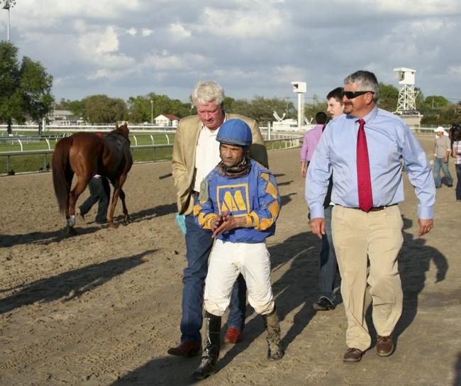 Trainer Steve Asmussen (far right, in the red tie) is one of the all-time career-win leaders in horse racing.