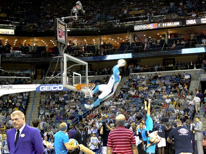 Hugo transformed into Super Hugo, shown here performing a flying dunk as the crowd and team looked on, as well as Air Hugo, an inflatable version of himself. Hugo did all of his own stunts.