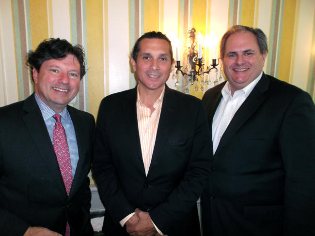 Peter Ricchiuti, Demetri Melekos of US Heritage Powersports, and Chip Stempeck of Elio Motors.