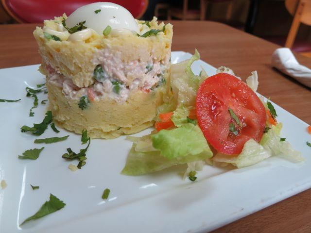 Causa rellena, a traditional Peruvian dish served at Las Carnitas.
