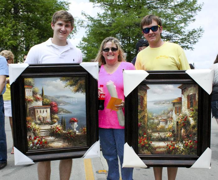 Cole, Penny and Kyle Davis, from Shreveport. This was their first Festival International... The trio traveled to Lafayette for the crafts.