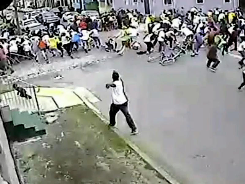 The police arrested Akein Scott, suspected of being the man in this image shooting into a Mother's Day second-line crowd this past Sunday. The image was taken from a surveillance video.