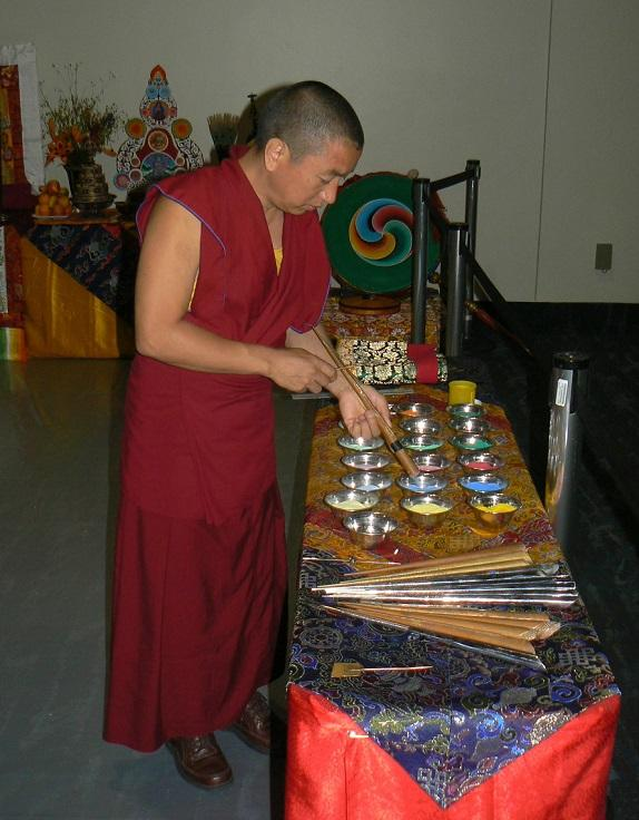 While chants echo in the background, monks prepare the multicolored sand used to build their project.
