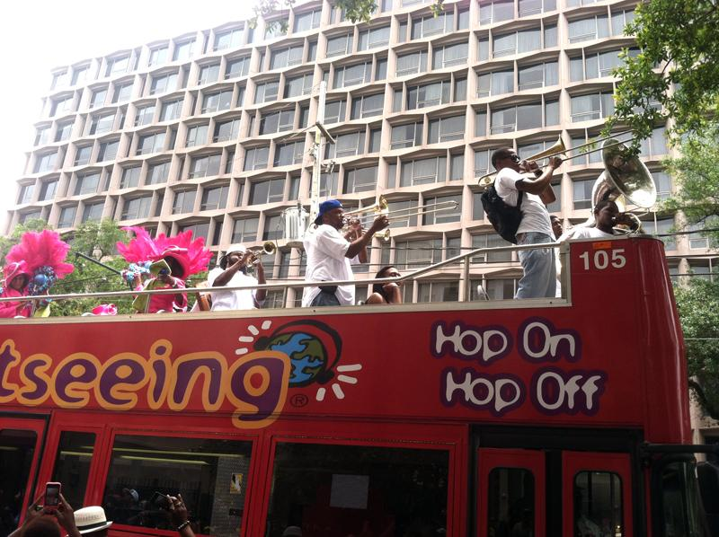 The Divine Ladies Social Aid & Pleasure Club arrived on the top of a double-decker tour bus on St. Charles Ave.