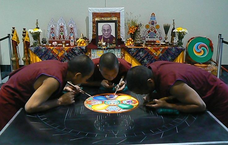 Just outside Hall G of the Ernest N. Morial Convention Center, Tibetan Monks are busy at work on a ritualistic spiritual exercise.