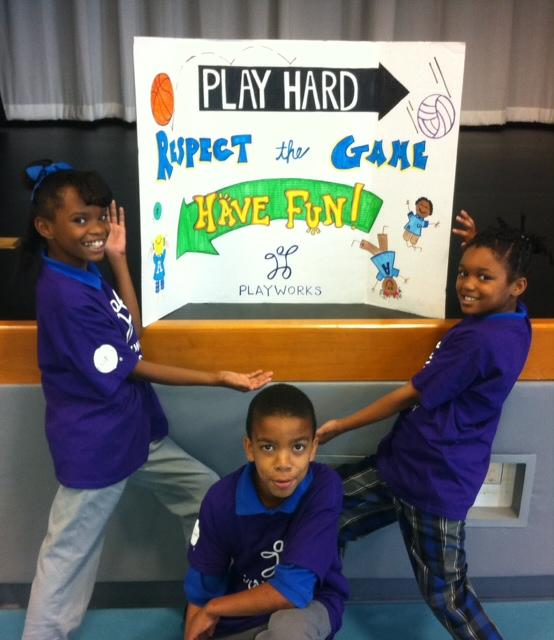 Jazmyn Simmons, left, with fellow junior coaches Matthew Scott, center, and Gabriell Jackson at Arthur Ashe Charter School.