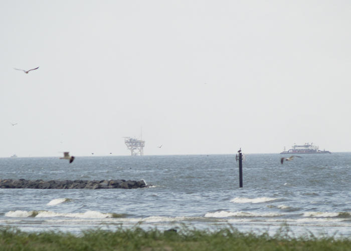 An oil platform and work boats off the coast of Grand Isle in 2010.