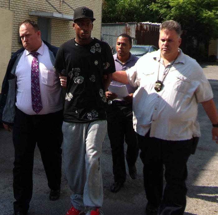 Shawn Scott, being escorted by police after his arrest Thursday.