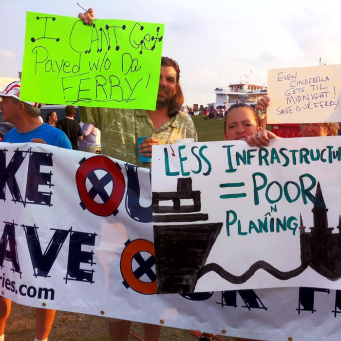 Protestors adjacent to the Algiers Point ferry terminal held a rally on the Fourth of July to protest the cuts to service.