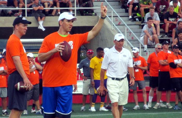 Brothers Peyton and Eli Manning gear up on the field at Nicholls State University for the Manning Passing Academy's Air It Out session this past Saturday.