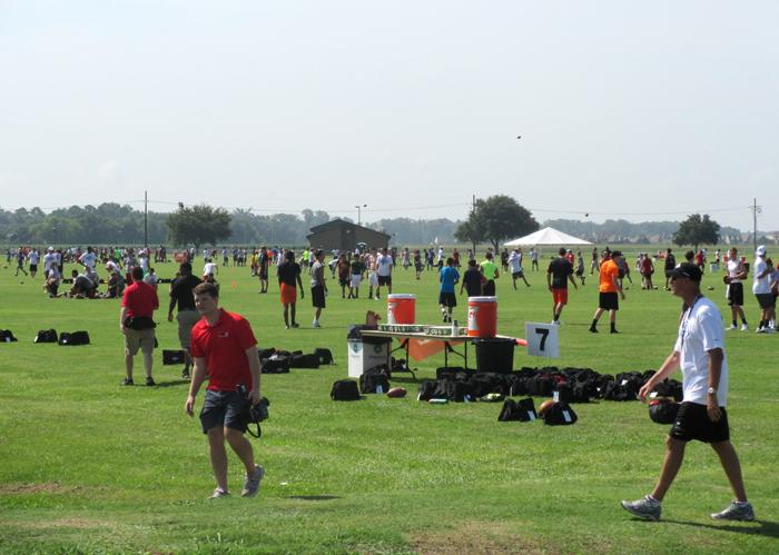 Hundreds of Manning Passing Academy campers practice on a 10-acre field at Nicholls State University.