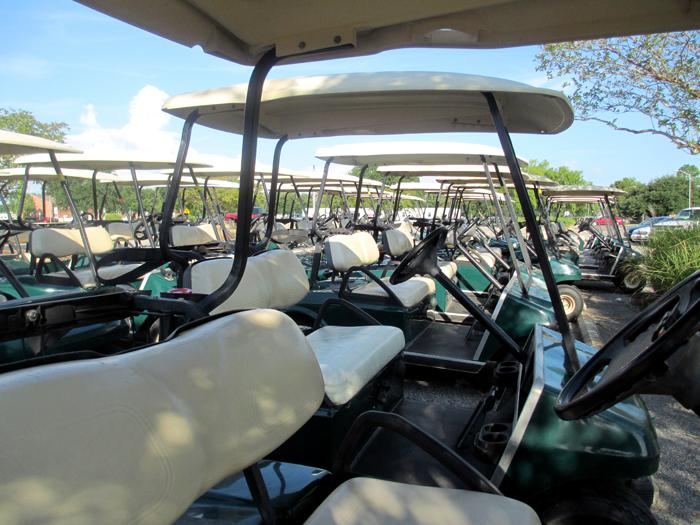 A fleet of golf carts stand ready to transport staff, equipment and, most importantly, water!