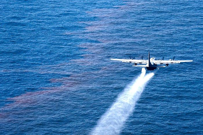 A C-130 Hercules from the Air Force Reserve Command's 910th Airlift Wing drops an oil-dispersing chemical into the Gulf of Mexico May 5, 2010, as part of the Deepwater Horizon response effort.