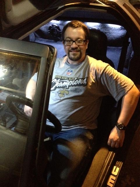 Farrar Hudkins, at the wheel of his DeLorean.
