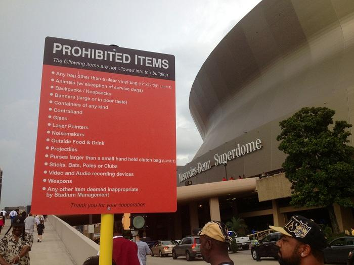 A new list of prohibited items posted at the bottom of the Superdome's Gate A ramp.