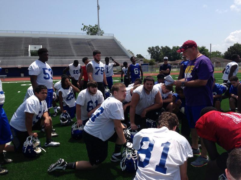 The team gather around Coach Salt for a pre-break huddle