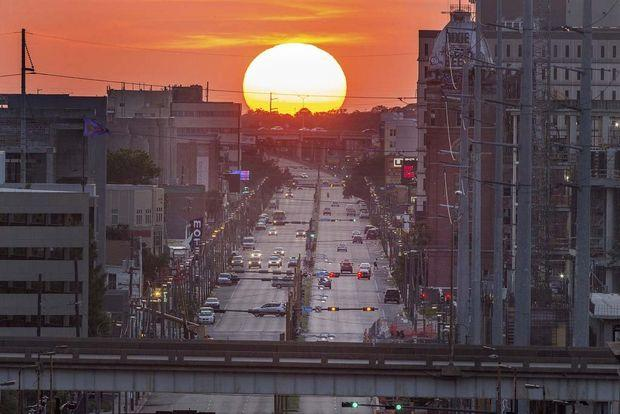 Sun sets on Tulane Avenue, where new business and the promise of redevelopment mix with longstanding crime and poverty.