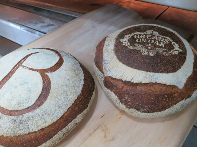 Loaves hot from the oven at the new Uptown bakery Breads on Oak.