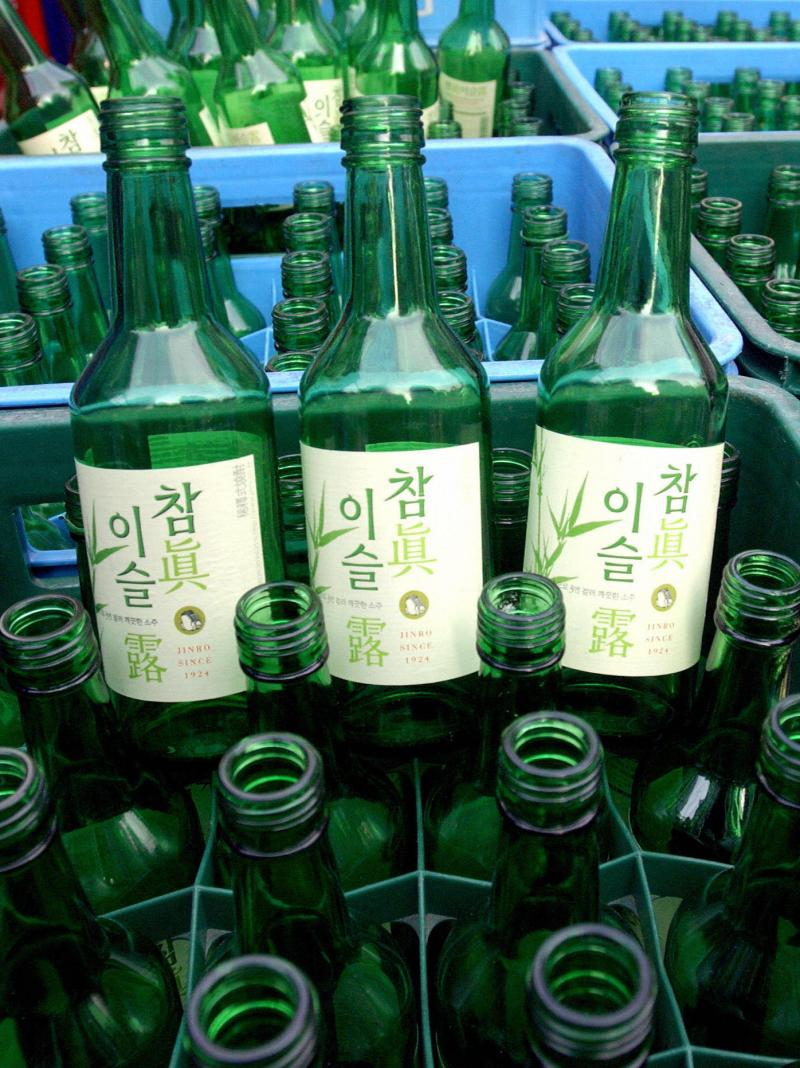 Boxes of empty Jinro soju bottles sit in a downtown Seoul, South Korea, shop on April 1, 2005.
